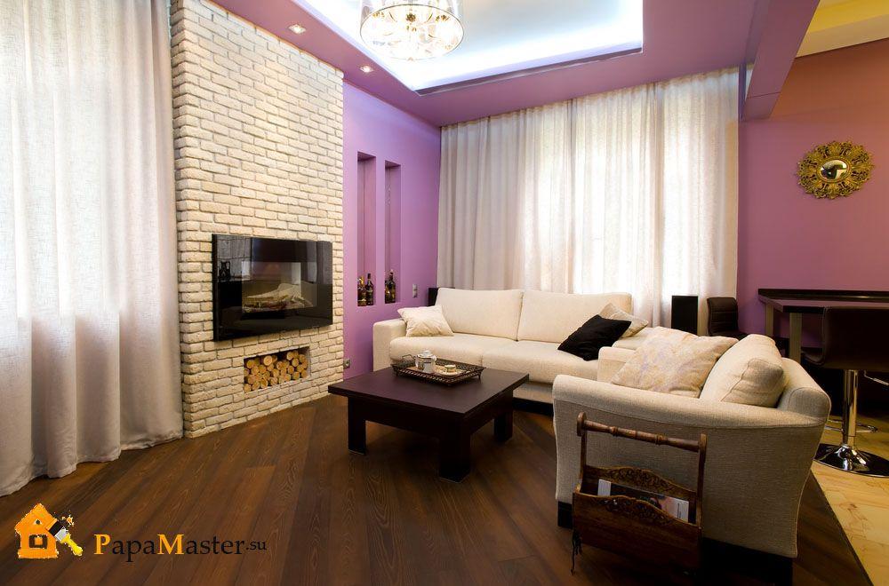 Дизайн зала с декоративным камином